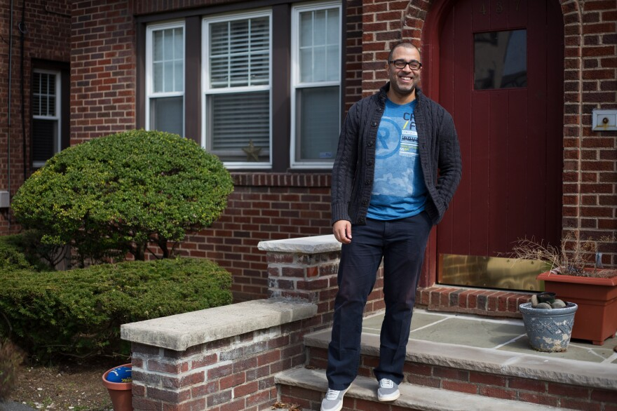 Anthony Mendez stands outside his home in Englewood, N.J. He got into voice acting after working for his family's tombstone business.