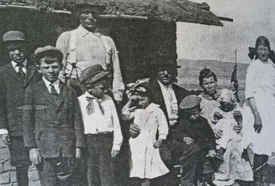 The Kochis family outside their sod house in 1914, the same year that they successfully earned the title to 160 acres of land under the Homestead Act.