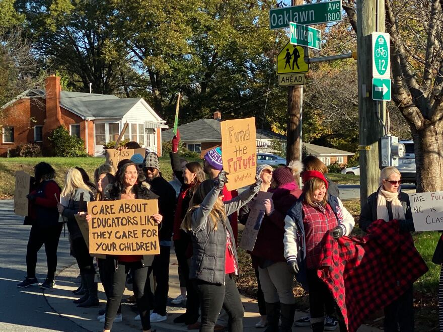 Teachers at Oaklawn Language Academy near uptown Charlotte protest before school Wednesday morning