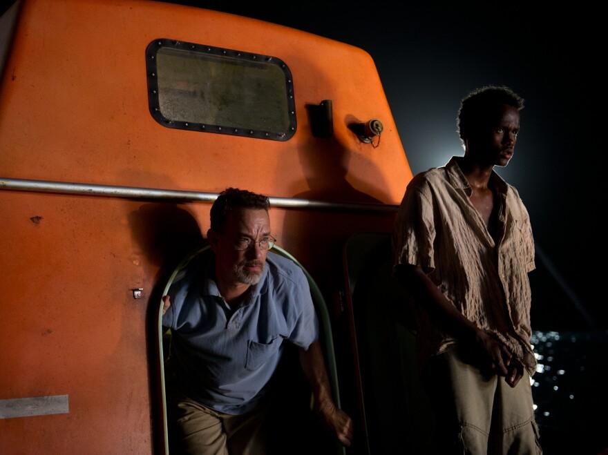 Tom Hanks and Barkhad Abdirahman share close quarters in <em>Captain Phillips</em>.