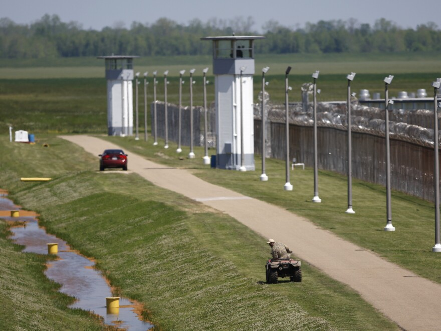 Louisiana State Penitentiary workers inspect levees near the prison, also known as Angola, in 2008. Henry Montgomery, who has been held there for more than 50 years after being sentenced to life at 17, may be resentenced after winning his Supreme Court case on Monday.