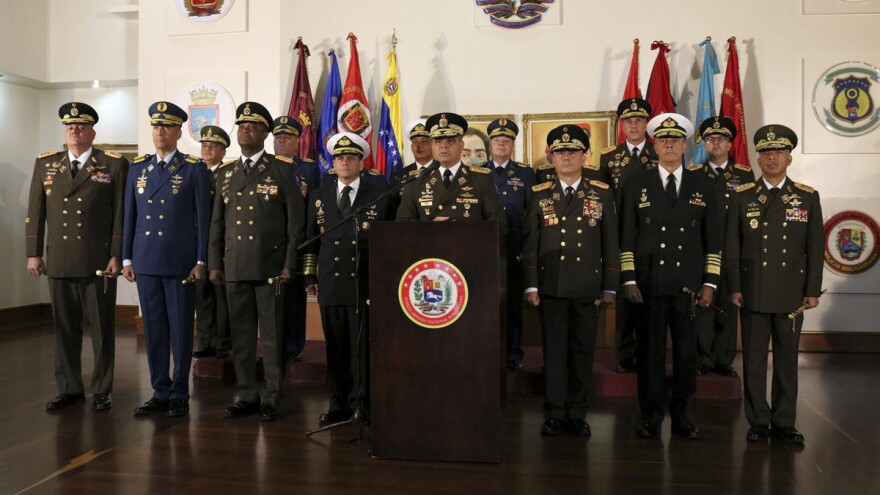 Defense Minister Vladimir Padrino López delivers a message of support for Venezuelan President Nicolás Maduro in Caracas, Venezuela, on Thursday. A half-dozen generals belonging largely to district commands and with direct control over thousands of troops joined Maduro in accusing the United States of meddling in Venezuela's affairs and said they would uphold the socialist leader's rule.