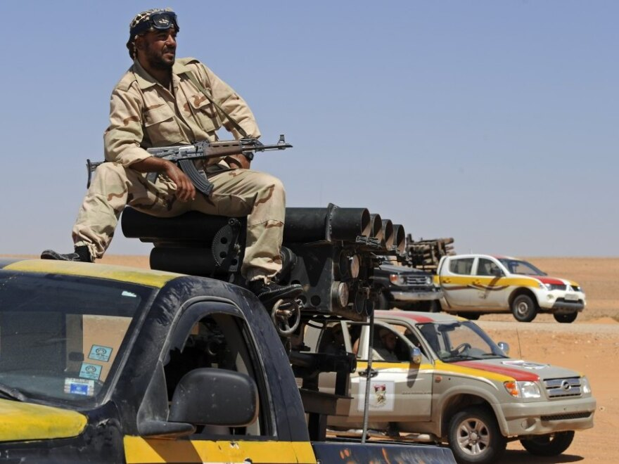 A Libyan National Transitional Council fighter keeps watch from atop his rocket launcher during a patrol mission near Wadi Bei, near the western city of Misrata, on Sunday.