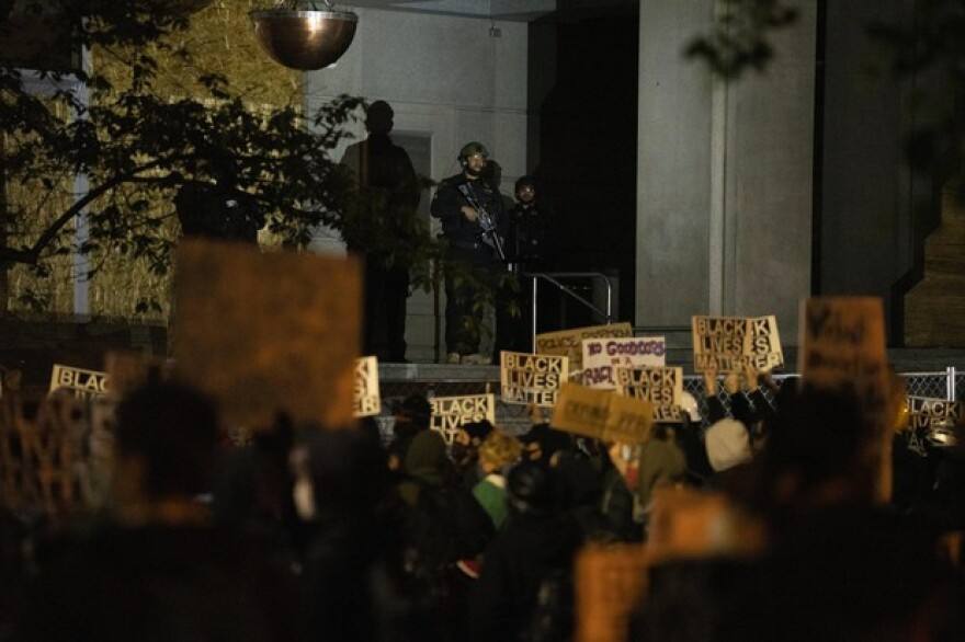Hundreds of protesters gathered at the Multnomah County Justice Center in the third week of widespread demonstrations against structural racism and police violence on June 15, 2020. Throughout the night protesters shined flashlights and laser pointers at police officers and sheriffs deputies, who ultimately used physical force and less lethal munitions to disperse the crowd