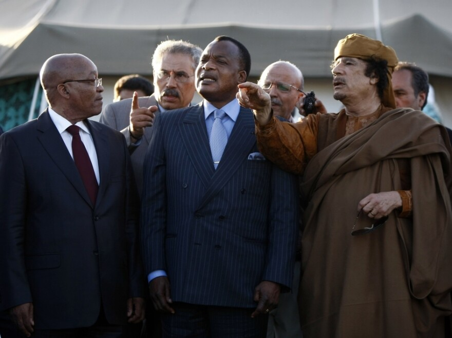 Libyan leader Moammar Ghadafi (right) speaks with presidents Jacob Zuma of South Africa (left) and Denis Sassou-Nguesso (center) of Congo outside a tent erected at his residence. A delegation from the African Union arrived in Tripoli Sunday in search of a cease-fire agreement.