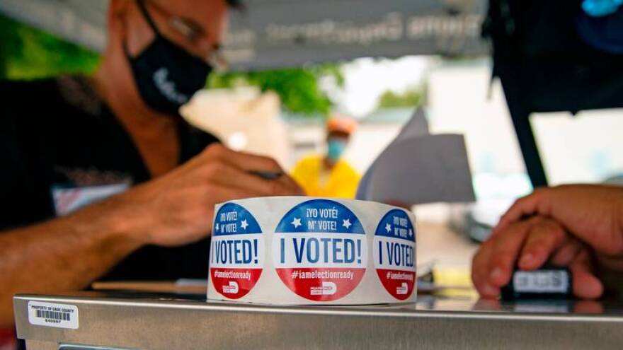 "A close-up photo of a roll of stickers emblazoned ""I Voted!"" at a polling site in Miami-Dade County."
