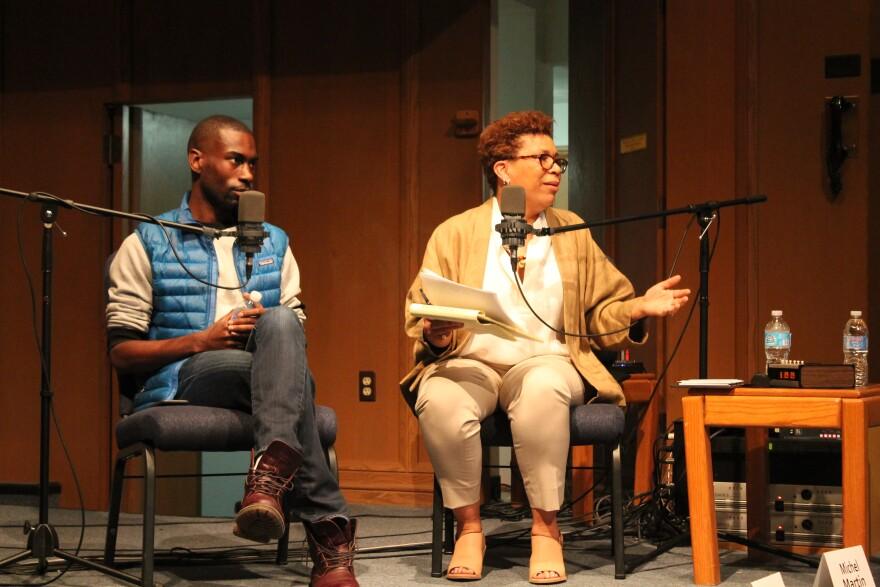 Activist DeRay Mckesson and NPR's Michel Martin address the crowd on March 23, 2015, during Ferguson and Beyond forum at Wellspring Church in Ferguson.