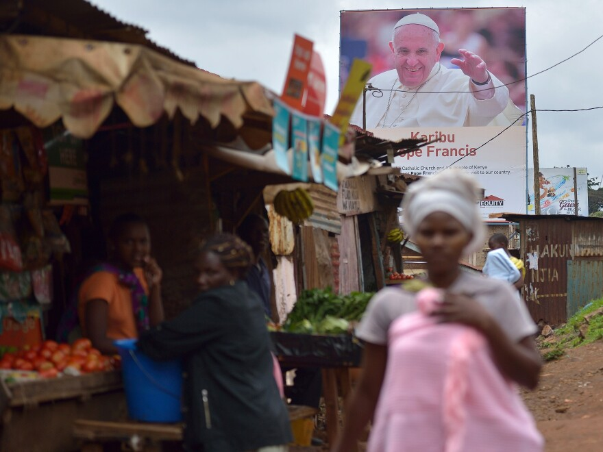 A poster in the Nairobi slum of Kangemi welcomes Pope Francis to Kenya.