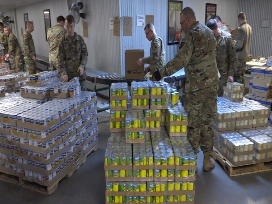 Members of the Ohio National Guard's 37th Infantry Brigade Combat Team out of Columbus package food at the Mid-Ohio Food Collective in March.
