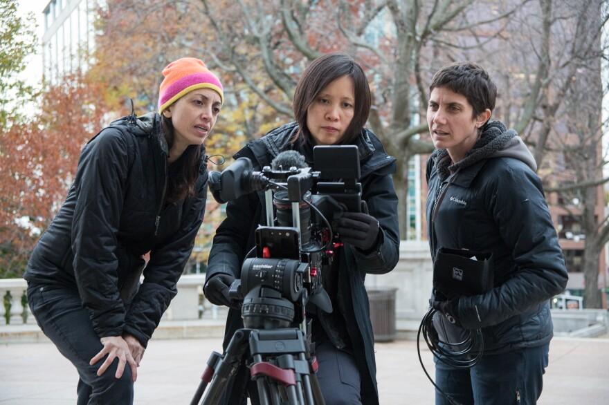 Filmmakers Laura Ricciardi (left) and Moira Demos (right) work alongside Iris Ng on the set of <em>Making a Murderer.</em>