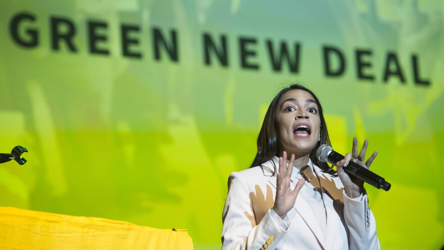 """Rep. Alexandria Ocasio-Cortez speaks about the Green New Deal in Washington, D.C., on May 13. She has shined a spotlight on a once-obscure brand of economics known as """"modern monetary theory."""""""
