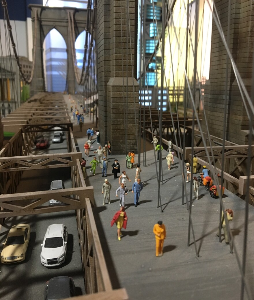 The exhibition's New York display, including a miniature Brooklyn Bridge, was created by local model-makers.