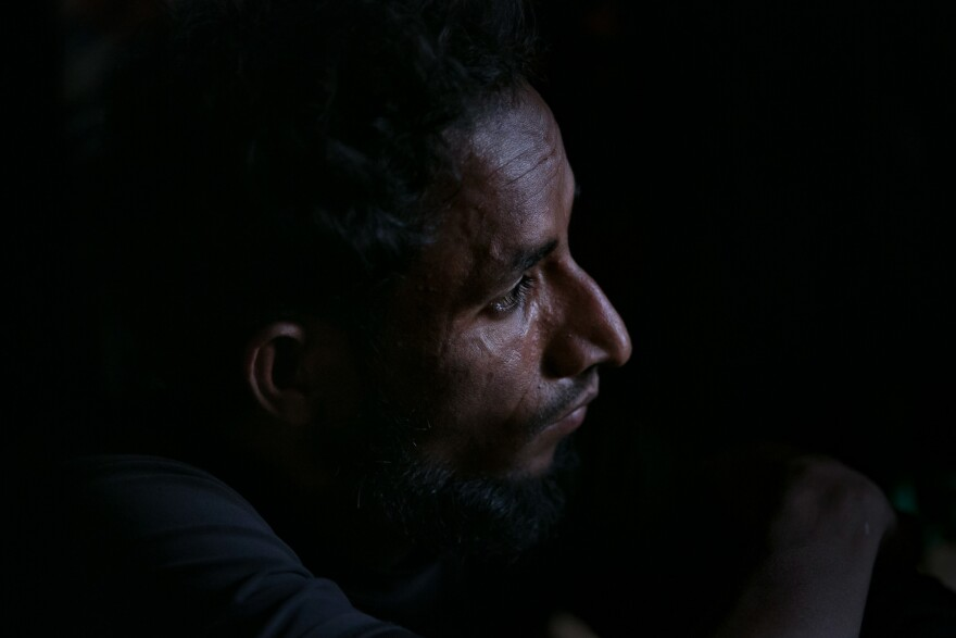 Mohamed Yonus in his home in the Hakimpara camp.