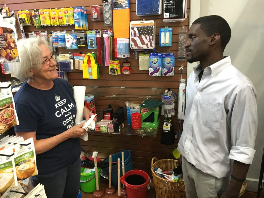 Bruce Franks talks with a supporter earlier in July 2016 on Washington Avenue.