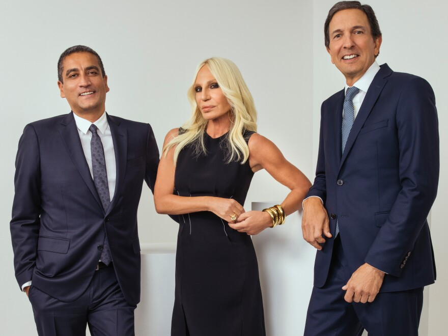Michael Kors is buying Italian fashion brand Versace for $2.12 billion. Here, Donatella Versace, artistic director of the company her brother founded, is flanked by Versace CEO Jonathan Akeroyd and Michael Kors Chairman and CEO John D. Idol.