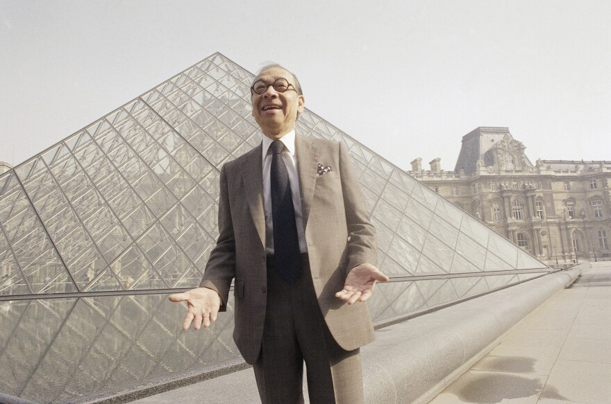 Architect I.M. Pei stands in front of the Louvre museum's glass pyramid in Paris, just before the structure's inauguration in March 1989.