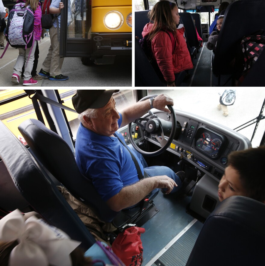 Kids board the bus.