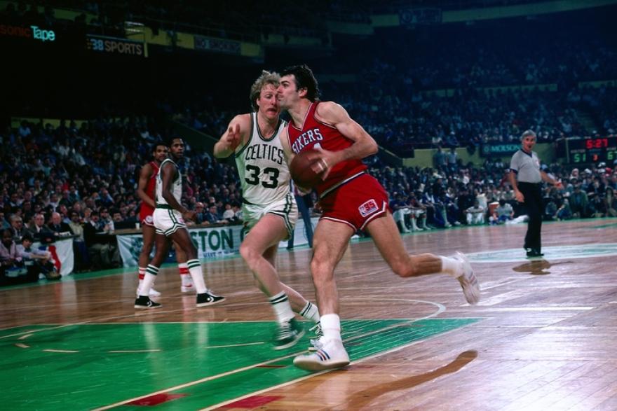 Bobby Jones driving on Larry Bird in a Philadelphia-Boston game in the '80s.