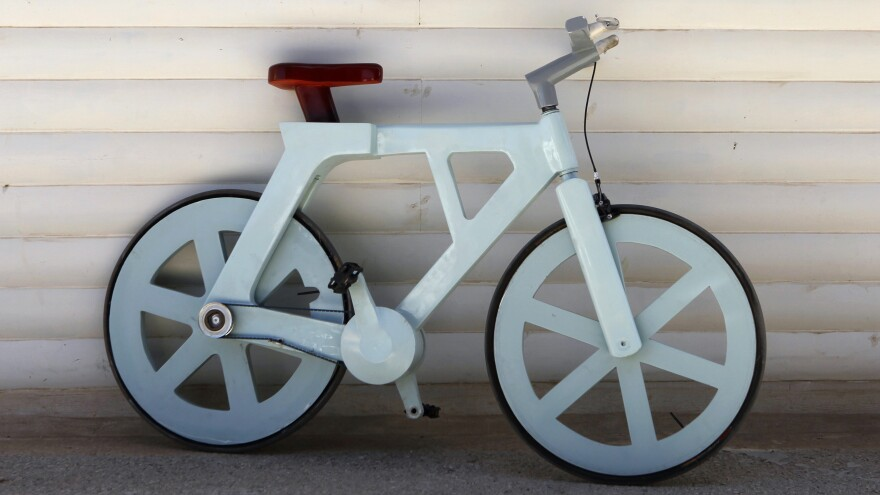 The cardboard bicycle.