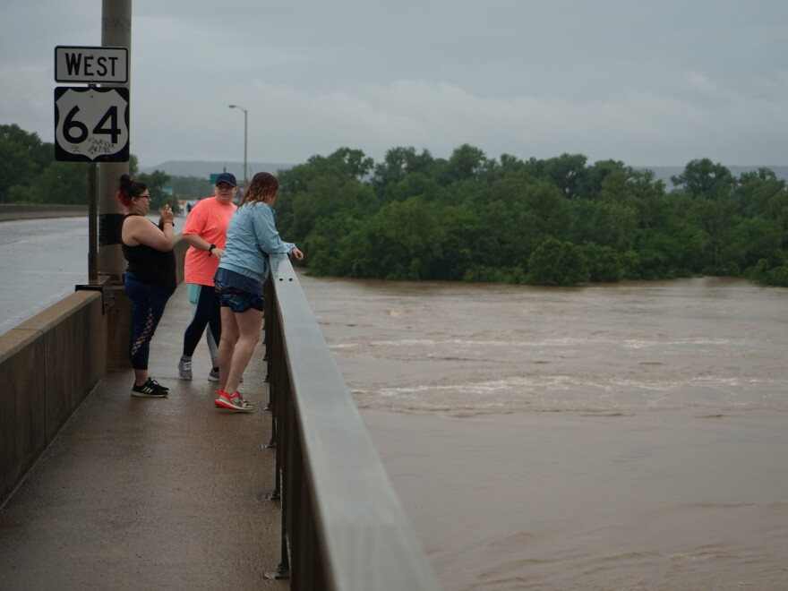 "A group of friends look at the record-high Arkansas River in Fort Smith, Ark. ""It's part of history now,"" says Savanna Bowling. ""We had to come see it."""