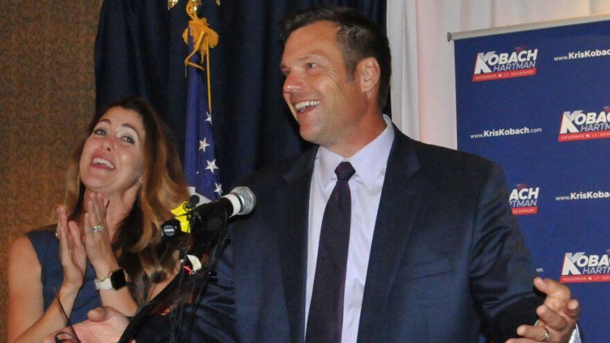 Kansas Secretary of State Kris Kobach, and his wife Heather Kobach, speak to supporters after last week's Kansas Republican gubernatorial primary.