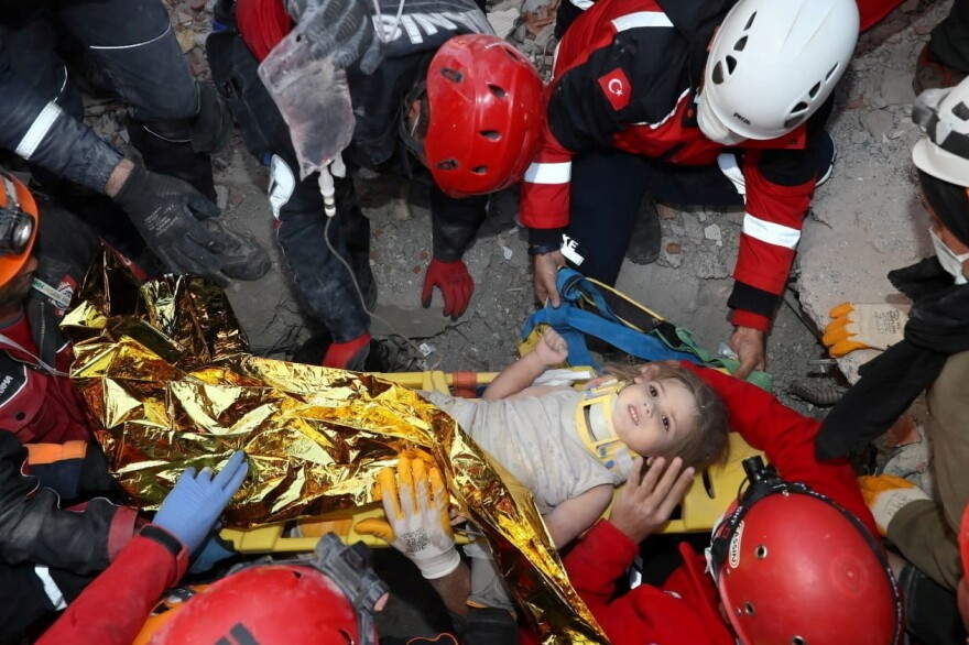 Rescue workers carry Ayda Gezgin away from where she was trapped by rubble after a building collapsed during last week's earthquake in the Aegean port city of Izmir, Turkey.