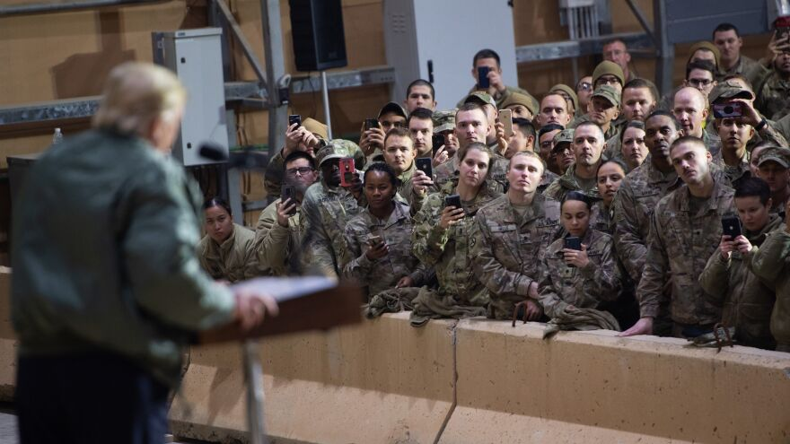 President Trump speaks to members of the U.S. military during an unannounced trip to Al Asad Air Base in Iraq on Dec. 26.