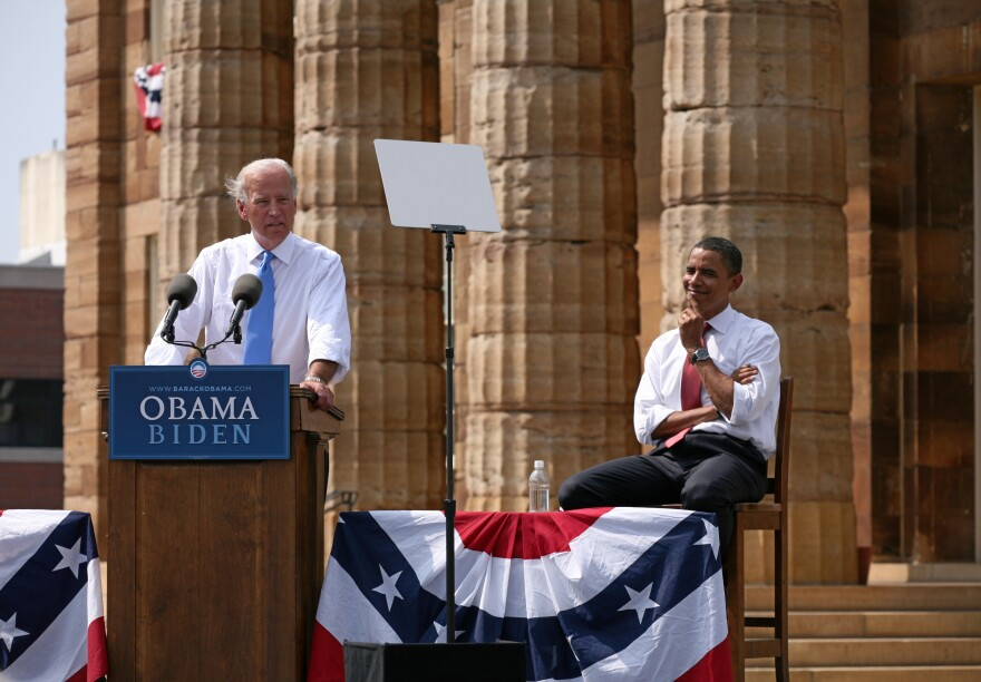 Joe Biden speaking at the August 23, 2008 vice presidential announcement in Springfield, Illinois, while presidential nominee Barack Obama listens.