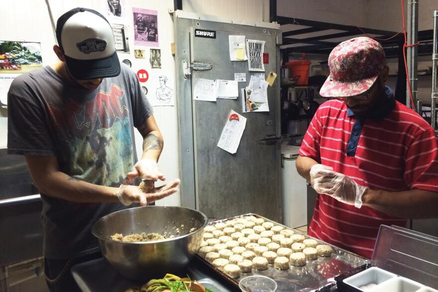 Roberto Diaz and Manuel Vasquez prepare croquettes made from green bananas and quinoa in the kitchen of <em>El Departamento de la Comida, </em>a farmers market and restaurant in San Juan.