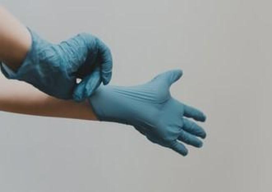Hands with medical gloves