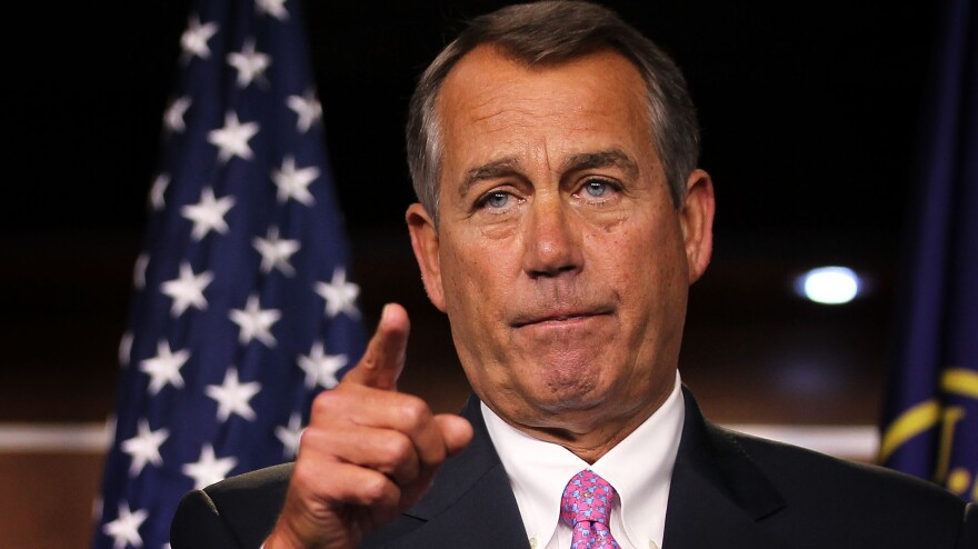 House Speaker John Boehner takes questions during a news conference Friday on Capitol Hill.