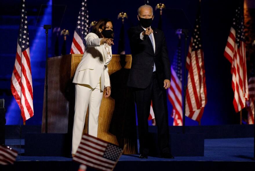 Democratic 2020 U.S. presidential nominee Joe Biden joins vice presidential nominee Kamala Harris onstage in Wilmington