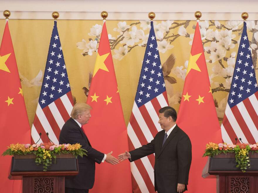 President Donald Trump and Chinese President Xi Jinping shake hands during a joint statement in Beijing last November. Donald Trump, among the least popular US presidents in decades and the newly empowered Chinese leader met for talks on trade and North Korea.