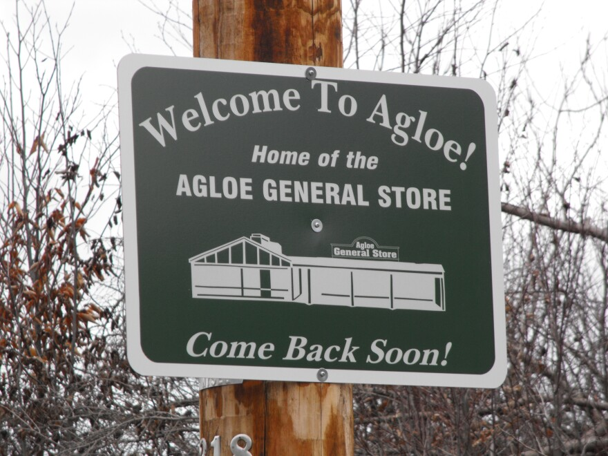 Agloe, N.Y., is a fictitious town created by cartographers to catch those who might copy their work. This sign stands where the coordinates appear on the map.