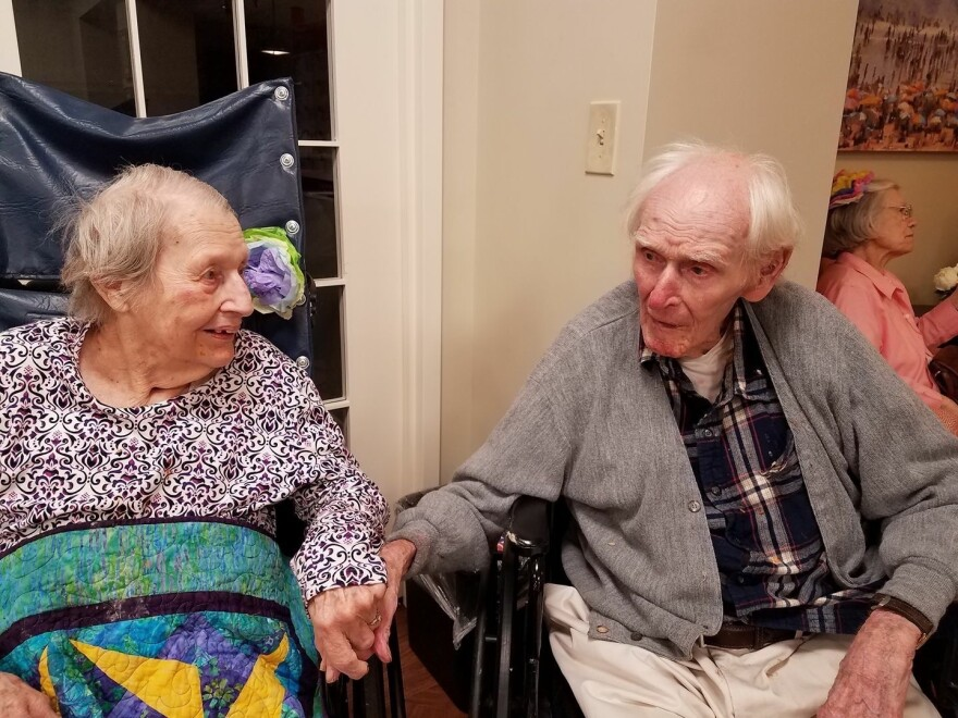 Isabell and Preble Staver hold hands in 2017. The couple served in World War II.