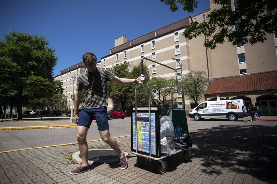 UT freshman Andrew Dareing moves his belongings out of the Jester-West dorm after campus shut down to help prevent the spread of the coronavirus.