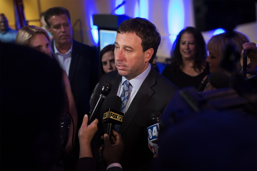 St. Louis County Executive Steve Stenger speaks to reporters after narrowly winning a primary election in August 2018.