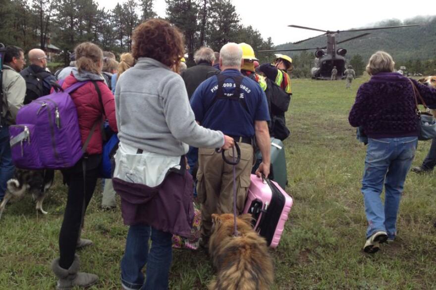 kgrimes-evacuees-headed-for-helo_09162013.jpg
