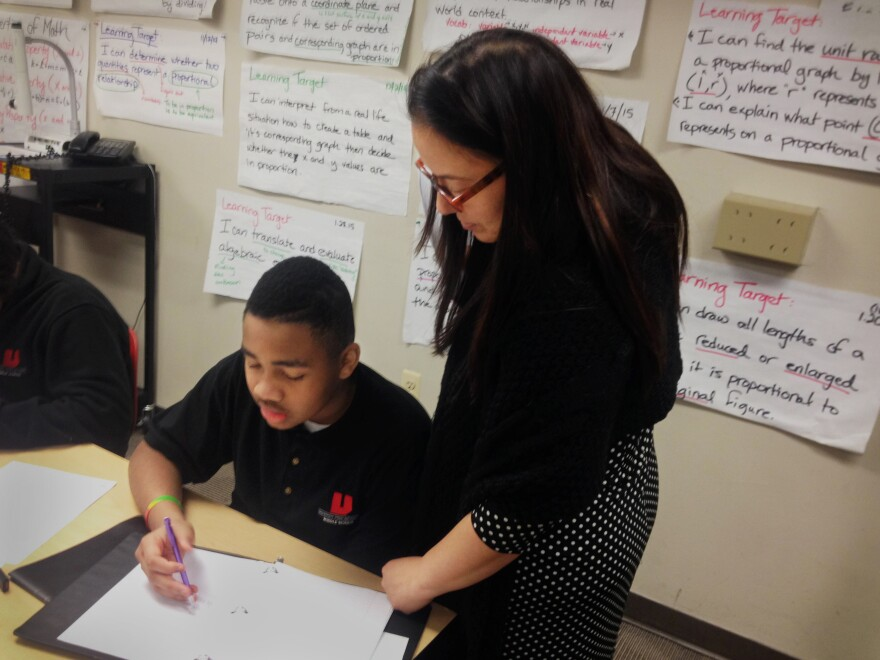 Teacher Jennifer Bahns helps her seventh-graders work through algebraic equations that, before the Common Core, were taught in eighth or ninth grade.
