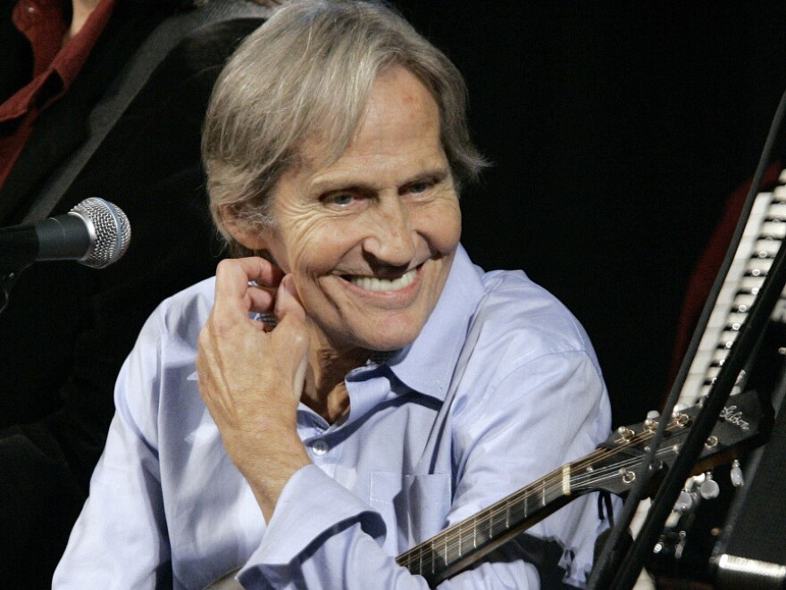 In this Dec. 3, 2007, photo, musician Levon Helm appears on <em>Imus in the Morning</em> in New York. The 71-year-old musician's family said Tuesday that he was in the final stages of cancer.