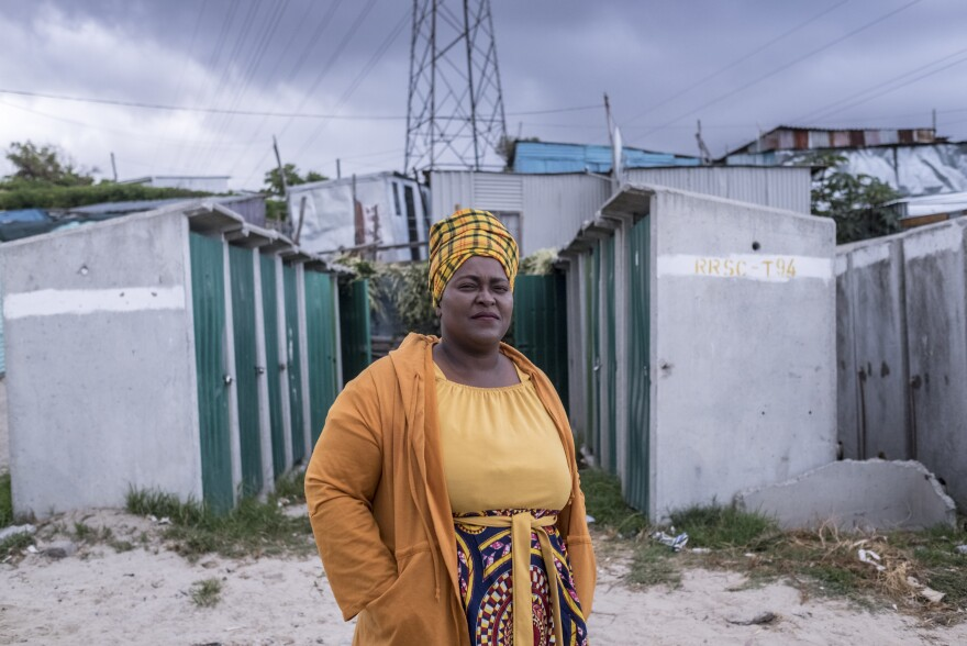 Zukwisa Qeso, who works for the Social Justice Coalition and is the head of her street committee, photographed near her home in the township of Khayelitsha, Cape Town, where she helps raise awareness about COVID-19.
