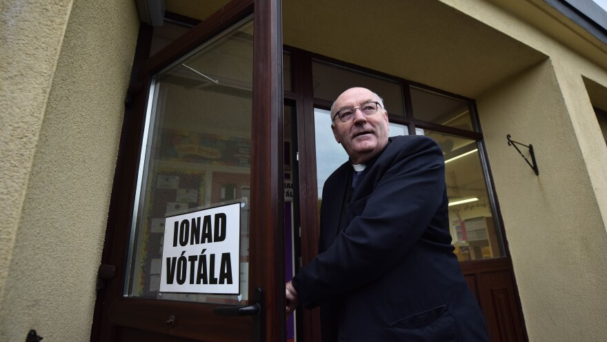Ted Harrington, a Catholic priest, casts his vote at a polling station Friday in Knock, Ireland. The Catholic Church has come out strongly against the effort to repeal the country's eighth amendment, which bans nearly all abortion.
