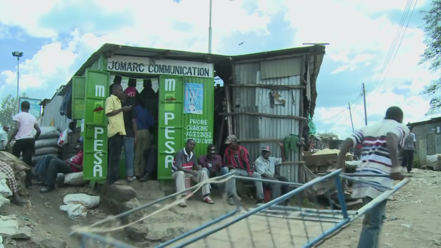 The M-PESA agent who works in this shop is part of a vast network of small-time vendors.