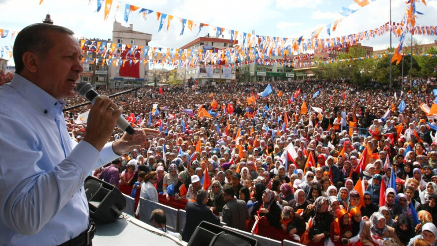 Turkish Prime Minister Recep Tayyip Erdogan addresses supporters during an election rally for his Justice and Development Party, or AK Party. Critics are concerned that the party could win a two-thirds majority in Parliament, which would allow them to rewrite the constitution without input from secular forces or the public.