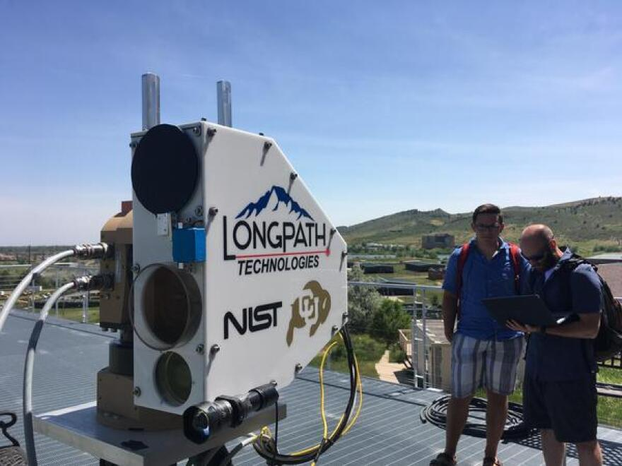 Researchers with the University of Colorado operate a laser that's scanning equipment in a field half a mile away, searching for hidden methane leaks.