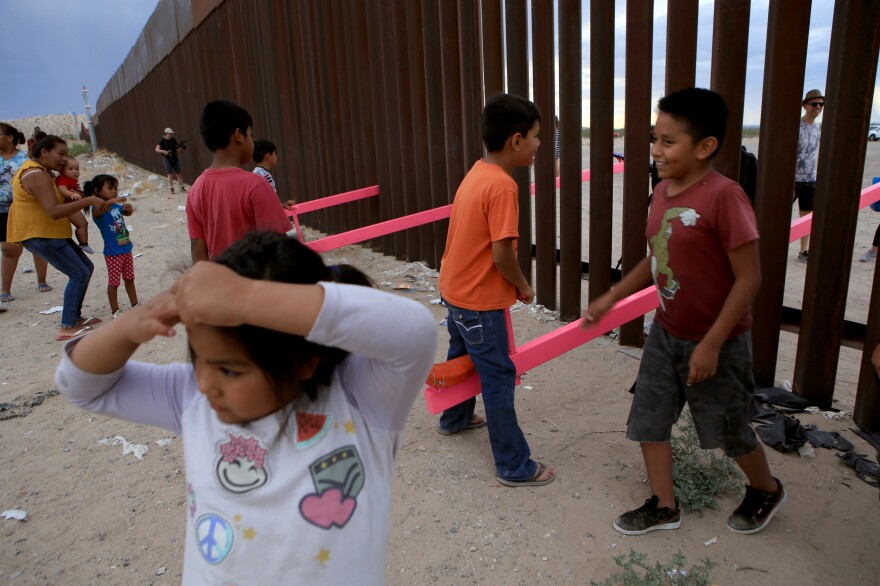 American and Mexican families play with a see-saw installation at the border near Ciudad Juarez, Mexico, in July of 2019. The project has been recognized by a prestigious design award.