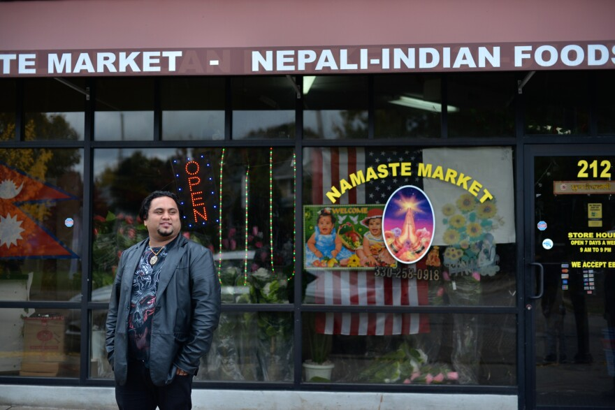 man in front of Nepali market