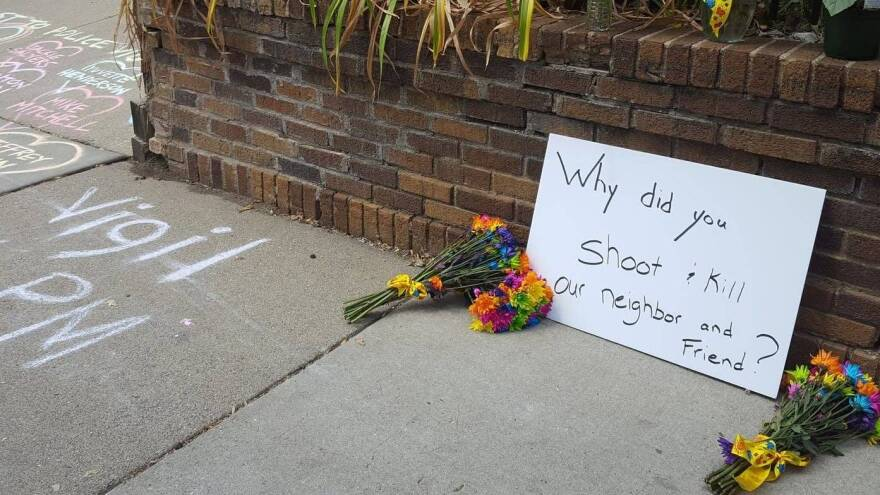 "A sign in south Minneapolis, where a woman was killed Saturday night by a police officer, reads ""Why did you shoot and kill our neighbor and friend?"""