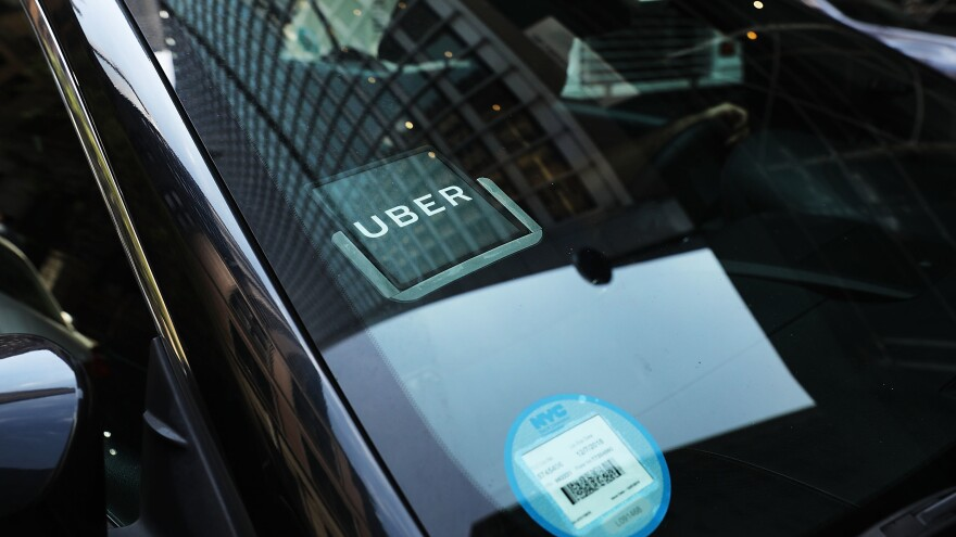 An Uber car waits for a client in Manhattan in June 2017. A study from MIT says most drivers are making less than minimum wage.