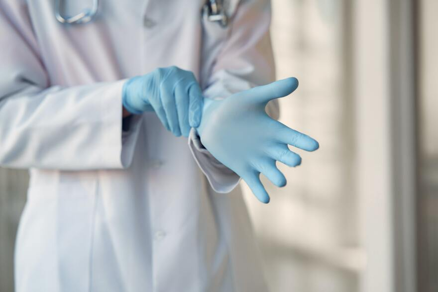 person-wearing-blue-sterile-gloves-3985168.jpg